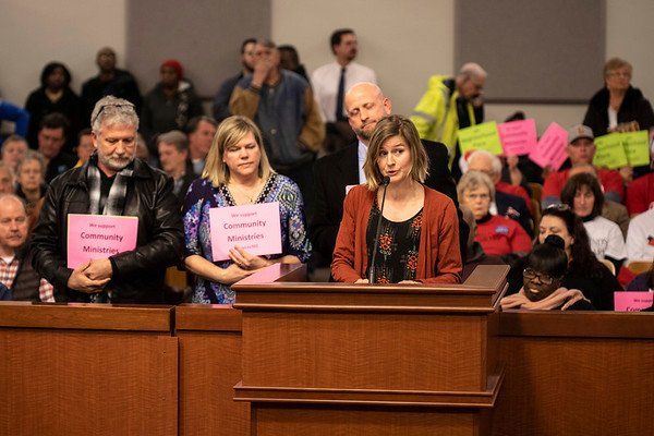 Clare Wallace (right) of the Association of Community Ministries addressed members of the Louisville Metro Council on Thursday night. 2/28/19