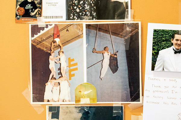 Photos of a younger Sedat Acton performing incredible feats of strength and aerialist stunts hang on the wall of his St. Matthews salon. 3/8/19