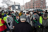 Members of the Ancient Order of the Hibernians huddle under cover at an old gas station near Broadway during a rain delay at the St. Patrick's Parade on Saturday. 3/9/19