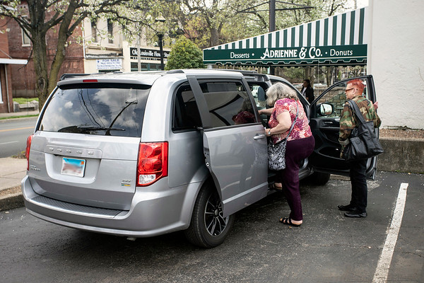 A few grocery shoppers climb into the van of Minister Stachelle Bussey on Saturday for an afternoon of errands. 4/6/19
