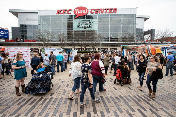 The Yum! Center plaza was a party zone for Kenny Chesney fans on Thursday night. 4/4/19