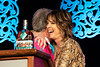 Hannah Storm hugs Louisville mayor Greg Fischer after being presented with several bourbons tied to the Kentucky Derby Festival during the annual They're Off! Luncheon on Friday. 4/12/19