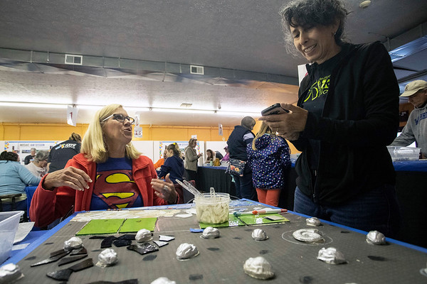 Cathy Gruninger and Chris Davey work on one of the mosaics to be used in a community made public art installation in the Jeffersonville NoCo Arts district. 4/20/19