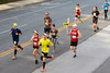 KDF Mini Marathon runners make their way through the last hilly portion of the course near the UofL campus on Saturday. 4/26/19