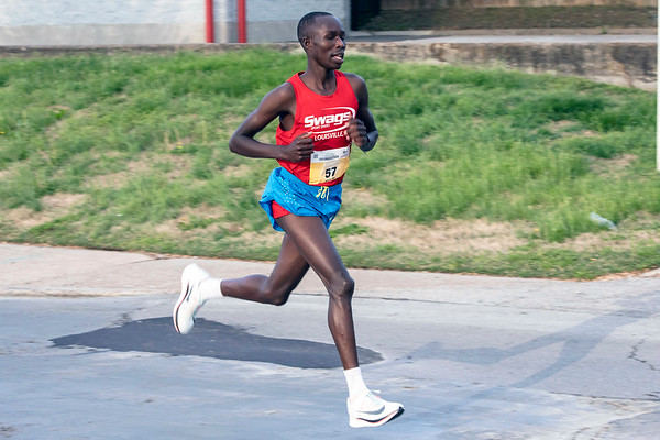John Korir of Voorthuizen, GE was on his way to a Saturday morning victory in the KDF Mini Marathon with a course time of 1:03:00.32. 4/27/19