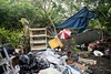 Debris left over from a once densely populated homeless camp on CSX property in the Irish Hill neighborhood waits to be removed on Monday morning. 4/29/19