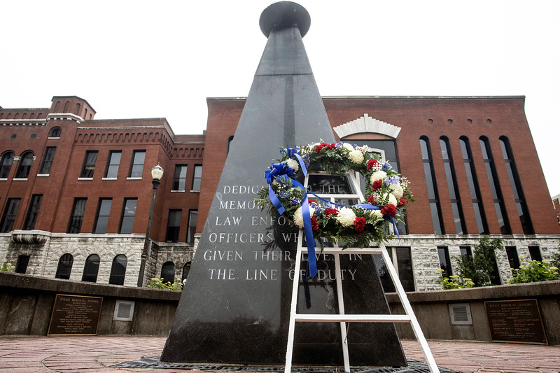 The police memorial near 6th & Liberty Streets was the backdrop for a Friday press conference by FOP president Nicolai Jilek as he discussed changes to the LMPD standard operating procedures manual. 5/10/19