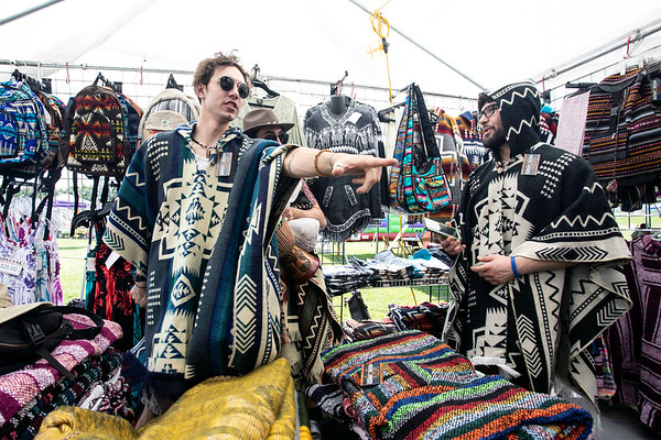 Josh Thomas spots a must have poncho in the marketplace at the annual Kentucky Reggae Festival. 5/25/19