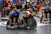 Red team member Mason Simons battles to move the ball down court during a quad rugby exhibition at the National Veterans Wheelchair Games on Thursday morning. 7/11/19