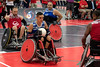 Former US Marine Joshua Burch moves the ball for his quad rugby team during the National Veterans Wheelchair Games at the Kentucky International Convention Center on Thursday morning. 7/11/19