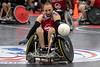 Quad rugby player Jesse Graham handles the ball for his team during the National Veterans Wheelchair Games. 7/11/19