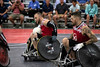 Quad rugby teammates Jesse Graham and Mason Simons move with the ball during a National Veterans Wheelchair Games exhibition match. 7/11/19