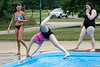 Arianna Wells cartwheels into the Sun Valley Community Pool as friends Summer Stull and Kiera Ferguson watch. 7/15/19