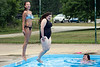 Friends Summer Stull and Kiera Ferguson try to time a jump together at the Sun Valley Community Pool on Monday. 7/15/19
