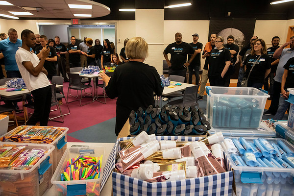 AT&T employees volunteered time on Tuesday morning to stuff bags with school supplies and hygiene products for returning students at Doss and Shawnee High Schools. 8/13/19
