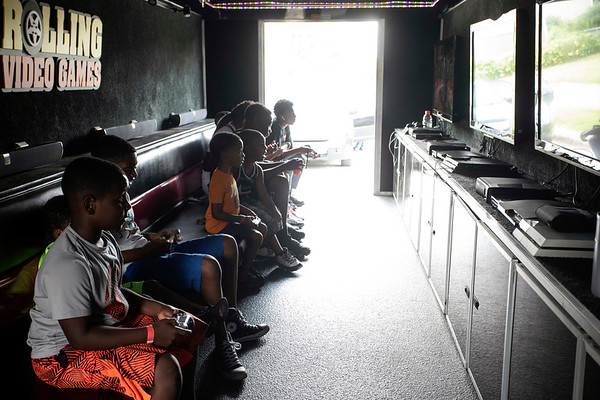 Friends and family of Ki'Anthony Tyus enjoyed shade and recreation courtesy of Rolling Videogames during a memorial picnic at Ballard Park in August. 8/17/19