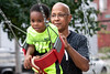 Christopher 2X gives one of his grandsons an assist on the swing set at Ballard Park during a memorial picnic for Ki'Anthony Tyus in August. 8/17/19