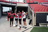 UofL football players gather near the refurbished lower bowl seats at Cardinal Stadium shortly after the announcement that funding for the job had been provided through a $1.5 million dollar donation from Zappos.com. 8/22/19