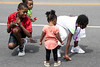 Children snatch up candy being thrown by participants in the Newburg Days parade on Saturday afternoon. 8/31/19