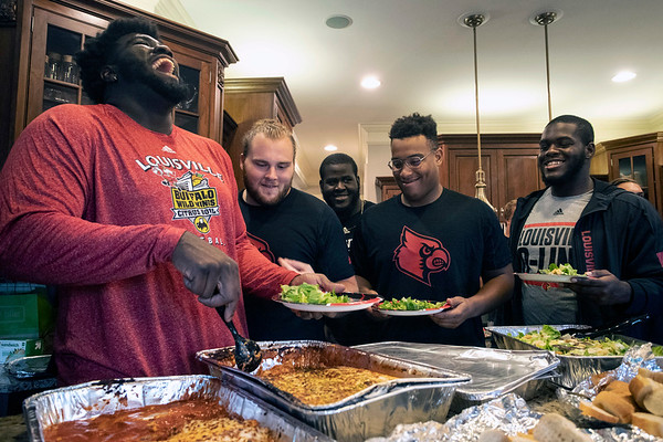 Members of the UofL offensive line gather in the home of coach Dwayne Ledford for dinner on a Thursday night. 9/5/19