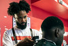 Alex Daniel takes care of customers at the Campus Barber Shop on Saturday afternoon during a Confess Project event. 9/7/19