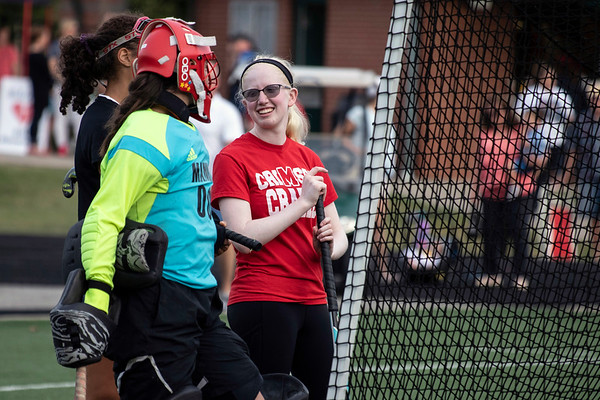 Addison Evers chats with her teammates before a field hockey game against Sacred Heart. 9/24/19