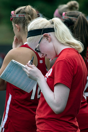 Senior Addison Evers keeps game stats as part of her role as the manager of the duPont Manual field hockey team. 9/24/19