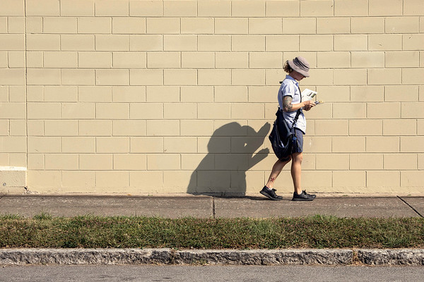 A US postal carrier navigates a sunny stretch of Swan Street on Monday as September officially ended as the hottest on record since 1925. 9/30/19