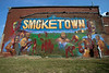 Artist Victor Sweatt continued his work on a Smoketown mural near the corner of Lampton and Hancock Streets despite the heat on Monday afternoon. 9/30/19