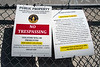 Recently posted signs along Floyd Street warn trespassers of prosecution and announce a clean-up date at the site later in the month. 10/3/19