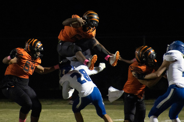 Fern Creek's Terrance Mitchell hurdled an Oldham County defender during a performance that included three touchdowns in a 38-15 victory on Friday night. 10/4/19