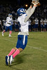 Oldham County's Parker Caudill brings in a high bouncing kicked ball during a loss to Fern Creek on Friday night. 10/4/19