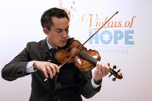 The Louisville Orchestra's Gabe Lefkowitz played one of the violins on display at the Frazier Museum as part of the Violins of Hope: Strings of the Holocaust. 10/10/19