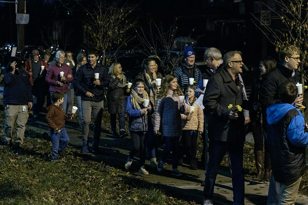 Participants in the Bobby Ellis Memorial Vigil walk east along Cedar Street on Sunday night. 11/24/19
