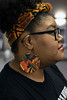 Artist Christian Butler wears a pair of her creations in the form of earrings. 12/17/19