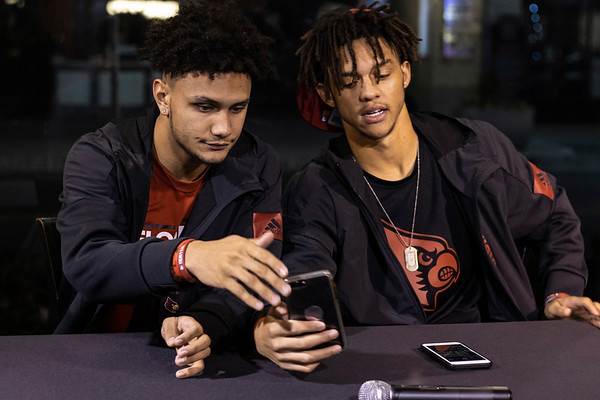 UofL football recruits and childhood pals Jordan Watkins and Josh Minkins waited for friends and family to arrive at Encore on Fourth Street Wednesday night as the pair held a letter of intent signing together. 12/18/19