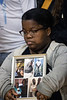 Monique Johnson clutched a framed montage of her brother Corey Johnson during a Sunday afternoon gathering at the YMCA on West Chestnut. Corey Johnson was killed on May 21, 2019 at the age of 27. 12/29/19
