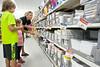 Nikki Shrader and her children, 5th grader Ryan and preschooler Shyanne, hunt for required school supplies at WalMart.