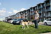 Waterside at River Park Place resident Bryce Gill takes his dog Roxie for a stroll. Already mindful of the rules in place for cleaning up after pets, Gill worries the potential new policy may come with an excessive price tag and heavier fines.