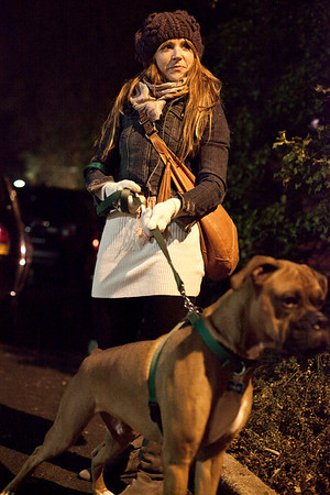 Kristen Cory and her boxer Tiny watch the crowds go by. (Photo by Marty Pearl)
