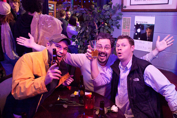 Billy Miller, Thomas Miller, and Kevin Kallbreier celebrate the holiday cheer at Monkey Wrench. (Photo by Marty Pearl)