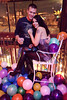 Surrounded by balloons and fresh from a midnight kiss, Sabrina Kiskuk and David Long pose for a colorful shot. (Photo by Marty Pearl)