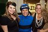 Jockey Jesus Castanon grabs a pic with Emily Calhoun and Olivia Makk.