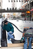 Crew members from Realm Construction Company install a skating rink at Fourth Street Live as part of the holiday preparations in Downtown Louisville.