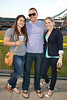 Stacy Robertson, Kyle Davidson, and Kelsey Pierson like the view from the outfield.