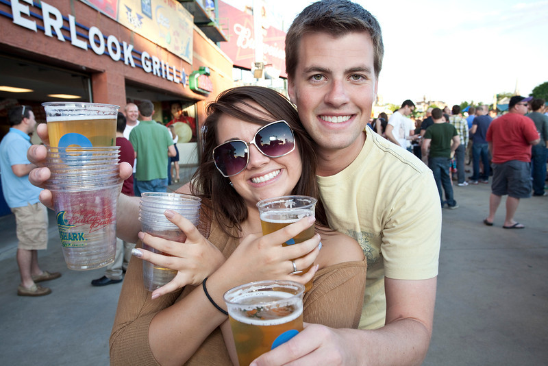 Chrissy Hanna and Scotty Anderson take advantage of $1 beers, great weather, baseball and good times as another Thirsty Thursday at Slugger Field comes and goes.