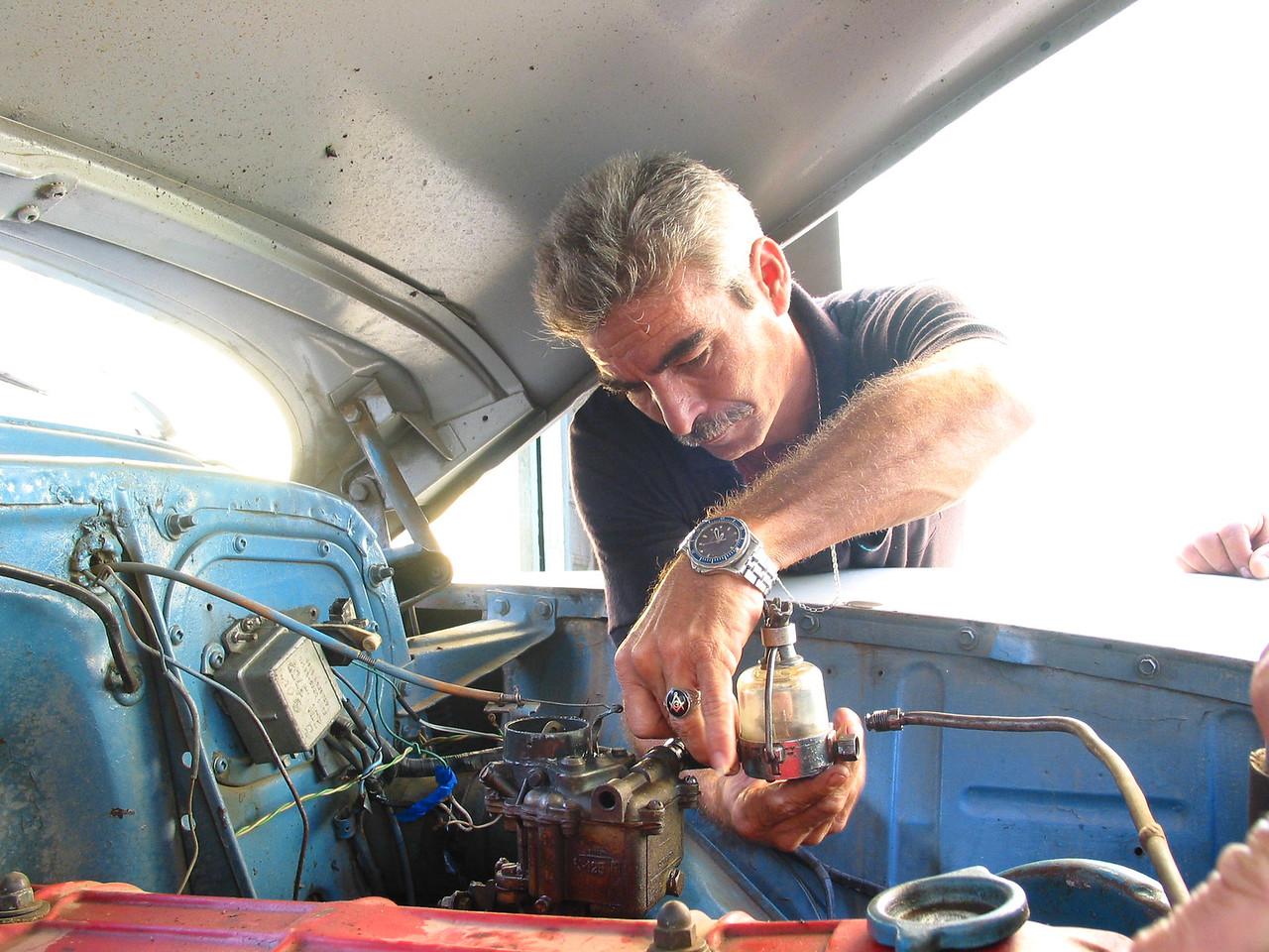 Repairing Car, Trinadad, Cuba.