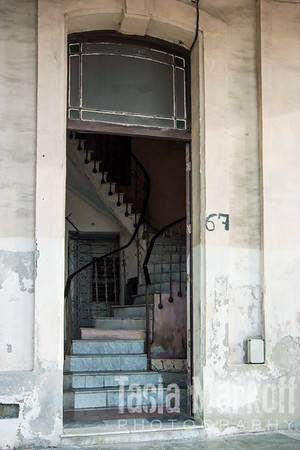 Building entrance with once-grand marble staircase