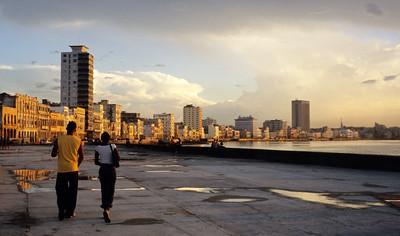A young couple walks Malecòn promenade