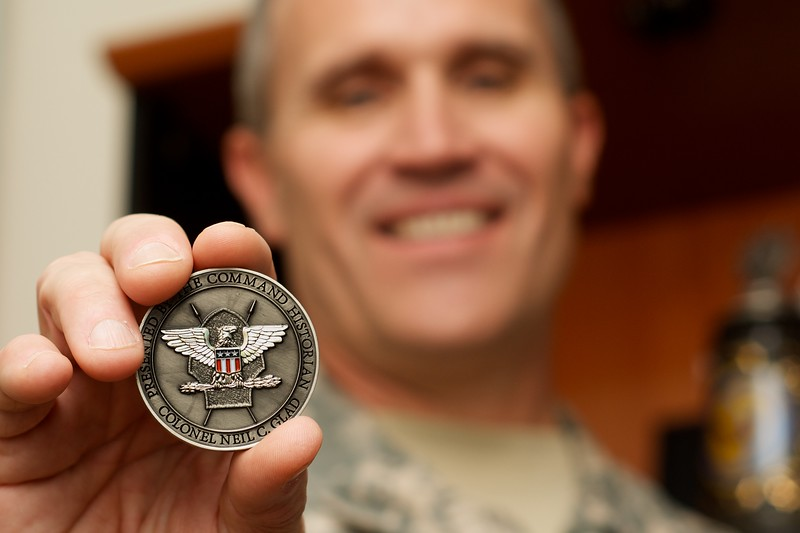 Day 293 -In the military it is a tradition to give coins to show appreciation for a job well done.  A few weeks ago I got this coin.  It was the first one out of the box, and extra special since I was fortunate enough to design it.  Special thanks to Col. Neal Glad for the opportunity to design his coin.  He's been a great to have around and always a big help to the office. -JUNE 25